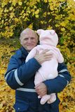 Happy grandfather with baby granddaughter outdoors Royalty Free Stock Photography