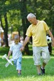 Happy grandfather and child in park Stock Photo