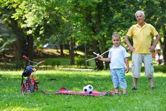 Happy grandfather and child in park Stock Image