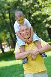 Happy grandfather and child in park Royalty Free Stock Photos