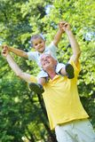 Happy grandfather and child in park Royalty Free Stock Image