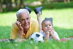 Happy grandfather and child in park Stock Photography