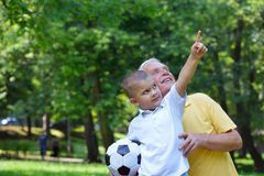 Happy grandfather and child in park Royalty Free Stock Images