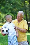 Happy grandfather and child in park Royalty Free Stock Photo