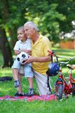 Happy grandfather and child in park Stock Photos