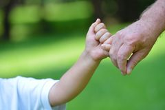 Happy grandfather and child in park Royalty Free Stock Photography