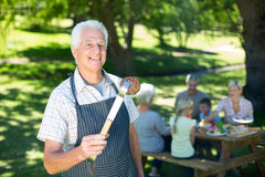 Happy grandfather doing barbecue Royalty Free Stock Photo