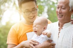 Grandfather, father and grandson. stock images