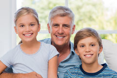 Happy grandfather and grandchildren Royalty Free Stock Photos