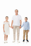 Grandfather and grandchildren holding hands. Happy grandfather and grandchildren holding hands together, isolated on white stock image