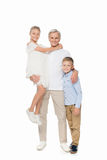 Grandfather and grandchildren hugging together. Happy grandfather and grandchildren hugging together, isolated on white stock photo