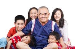 Happy grandfather and grandchildren. Joyful moment stock image