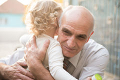 Happy grandfather with granddaughter Stock Photo