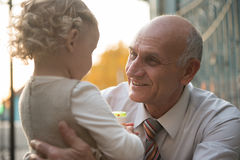 Happy grandfather with granddaughter Stock Images