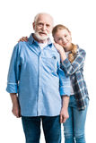 Happy grandfather and granddaughter hugging. Isolated on white in studio Stock Image