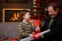 Happy grandfather with grandson at christmas Royalty Free Stock Image