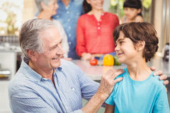 Happy grandfather and grandson with family. At home royalty free stock images