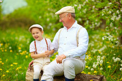 Happy grandfather and grandson playing in spring garden Royalty Free Stock Photography