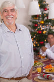 Happy grandfather standing at christmas Stock Image
