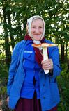 Happy grandma with a big fly agaric Stock Photo
