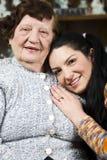 Happy grandma and granddaughter stock images