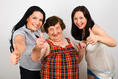 Happy grandma with granddaughters give thumbs Royalty Free Stock Photos
