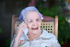 Happy grandma talk with phone Royalty Free Stock Image