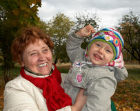 Happy grandmother. Holding her granddaughter in her arms Stock Photography