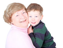 Happy Grandmother. Grandmother hugging handsome grandson isolated on white Stock Photography