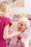 Happy grandmother. With smile on face taking present Royalty Free Stock Images