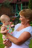 Happy grandmother with baby girl Stock Photos