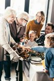 happy grandmother carrying turkey for family royalty free stock image