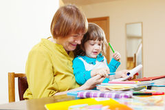 Happy grandmother and child sketching on paper Stock Photos