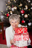 Happy grandmother with Christmas gifts Royalty Free Stock Photo
