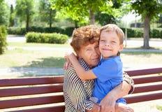 Happy grandmother with grandchild. Grandmother with grandchild. Old women with grandson Royalty Free Stock Photo