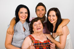 Happy grandmother with grandchildren. United family of grandchildren and grandma standing together in a hug,check also Grandmother royalty free stock images