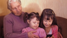 Happy grandmother with grandchildren. stock footage