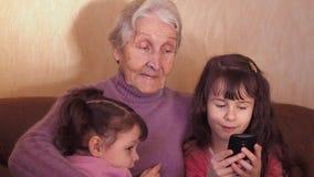 Happy grandmother with grandchildren. Full hd stock video