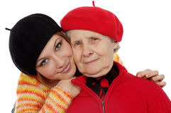 Happy grandmother and granddaughter with berets Stock Photo