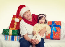 Happy grandmother and granddaughter with christmas box gift - holiday concept Royalty Free Stock Photo