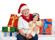 Happy grandmother and granddaughter with christmas box gift - holiday concept Royalty Free Stock Image