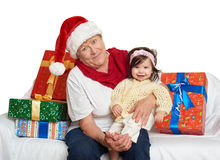 Happy grandmother and granddaughter with christmas box gift - holiday concept Stock Images