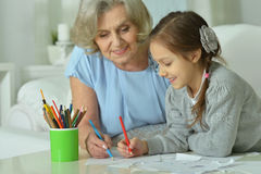 Happy Grandmother with granddaughter drawing Royalty Free Stock Photography