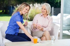 Happy Grandmother And Granddaughter Playing Cards Royalty Free Stock Photo