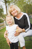 Happy Grandmother and Granddaughter Playing At The Park Royalty Free Stock Images