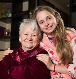 Happy grandmother and granddaughter. Posing at home Stock Images