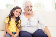 Happy grandmother and granddaughter smiling Stock Photos