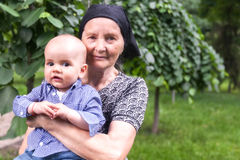 Happy Grandmother With Her Baby Grandson Stock Photos