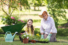 Happy grandmother with her granddaughter gardening Royalty Free Stock Photos