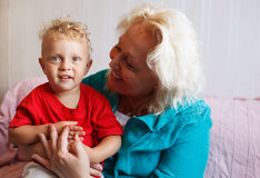 Happy grandmother with her little grandson. Royalty Free Stock Photo